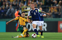 Lithuania's Arturas Zulpa (left) and Scotland's Scott Brown battle for the ball during the 2018 FIFA World Cup Qualifying, Group F match at the LFF Stadium, Vilnius.