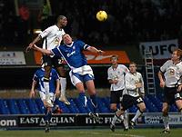 Photo: Ashley Pickering.<br />Ipswich Town v Leeds United. Coca Cola Championship. 16/12/2006.<br />Leed's Tresor Kandol (white) beats Jason De Vos to fire in a header