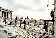 Acropolis, Propylaea, workmen doing repairs with scaffolding and tools.
