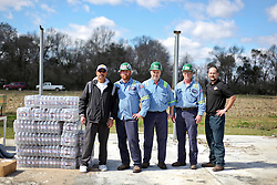 24 February 2016. Schexnaydre St, Convent, Louisiana.<br /> Scenes of devastation following a deadly EF2 tornado touchdown. 2 confirmed dead. <br /> Local Councilman Ralph Patin of district 4 with volunteers from steel giant NUCOR Corporation helps with the deliveries of vital supplies donated to neighborhoods hardest hit by the storm.<br /> Photo©; Charlie Varley/varleypix.com