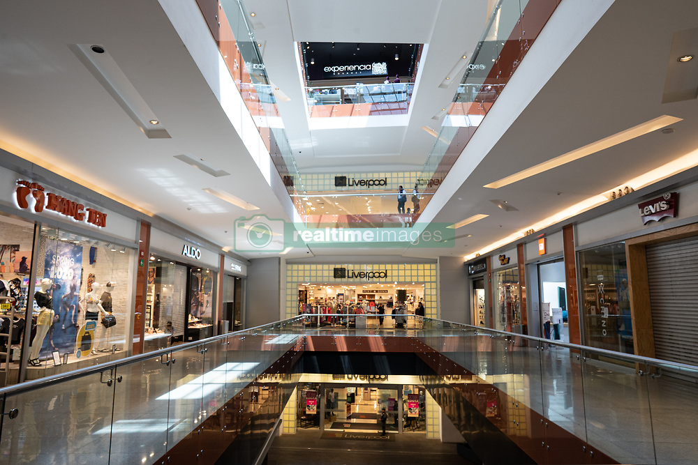 The empty commercial shopping centre, Parque Delta, in the middle of the city on a Saturday. Some shops were completely closed, others open for business but without customers. Photo credit should read: Lexie Harrison-Cripps/EMPICS Entertainment