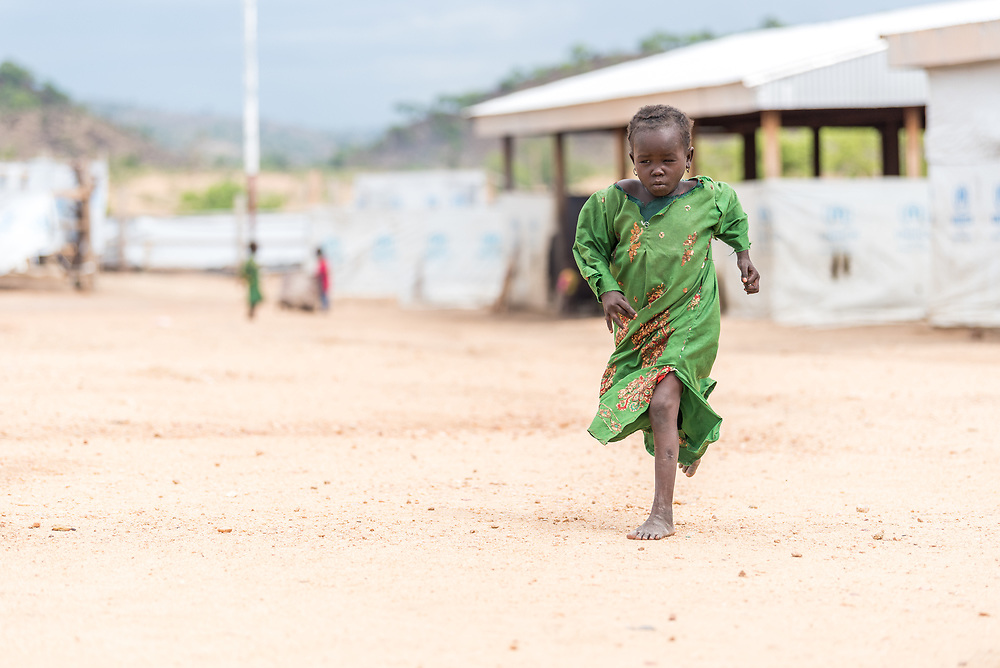 30 May 2019, Mokolo, Cameroon: A girl runs through the transit zone to Minawao camp for Nigerian refugees. Before being settled in the camp, newly arriving refugees are hosted in the transit zone until their arrival has been registered by UNHCR. The Minawao camp for Nigerian refugees, located in the Far North region of Cameroon, hosts some 58,000 refugees from North East Nigeria. The refugees are supported by the Lutheran World Federation, together with a range of partners.