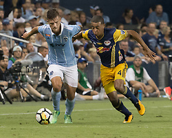 September 20, 2017 - Kansas City, Kansas, U.S - Sporting KC forward Diego Rubio #11 is on defense against NY Red Bulls midfielder Tyler Adams #4 during the second half of the game. Sporting KC will win the 2017 Lamar Hunt Open Cup championship with a score of 2-1 over the New York Red Bulls. (Credit Image: © Serena S.Y. Hsu via ZUMA Wire)
