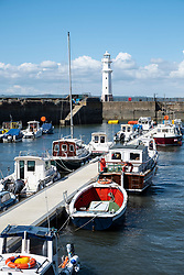 Boats in harbour on Firth of Forth at Newhaven in Edinburgh, Scotland, United Kingdom