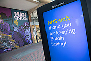 HM Government, and NHS advertising boards thanking NHS staff beside some graffiti spelling out Mass Hysteria in Birmingham city centre is virtually deserted due to the Coronavirus outbreak on 24th April 2020 in Birmingham, England, United Kingdom. Coronavirus or Covid-19 is a new respiratory illness that has not previously been seen in humans. While much or Europe has been placed into lockdown, the UK government has extended stringent rules as part of their long term strategy, and in particular social distancing, which has left usually bustling areas like a ghost town.