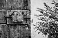 Black and white photo, unique doorway in San Quirico d'Orcia, Italy