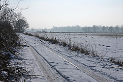 Tyre tracks on a snowy road, Schleswig-Holstein, Germany