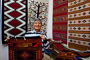 A local artisan shows his rugs. Oaxaca in southern Mexico is known for its artisan communities, with each valley having a different specialism - weaving, pottery, wood carving.