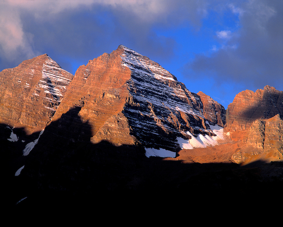 Both the early light and striations of snow enhance Maroon Bells, Aspen, Colorado.