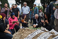 Verses from the Quran are read at the scemetery in Soma, where those killed in the major mining incident are being laid to rest. An electrical fault caused an explosion in the shaft resulting in at least 282 workers being killed in the disaster. Soma, Western Turkey.