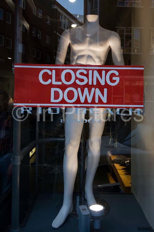 """An announcement banner of a business' imminent closure is in the window of a Rio Beach clothing outlet on a fashion mannequin in their Earlham Street shop. Their web site says: """"Rio Beach sells men's clothing for the beach and beyond. As one of the only places that stocks fashionable swimming trunks year round, this is a useful place if you're planning an unseasonable holiday."""""""