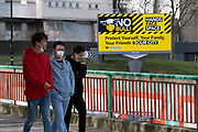 As the third national coronavirus lockdown in Birmingham continues, people interact with a new public health advice advertising campaign featuring Bully the Bull Ring bull wearing a face mask with the slogan NO bull, Hands, Space, Face in the city centre on 30th March 2021 in London, United Kingdom. After months of lockdown, the first signs that life will start to get back to normal begin, with more people enjoying the company of others in public, as the rule of six starts the first stage of lockdown ending.