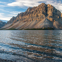 Crowfoot Mountain looms above Bow Lake in Banff National Park, Alberta, Canada.