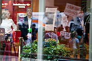 Customers of Bank of America stare across the glass at people marching in Boston, Massachusetts, September 30, 2011.