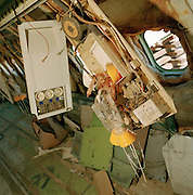 Oxygen mask survival equipment in airliner cabin at Mojave airport desert facility, awaiting recycling for scrap value.