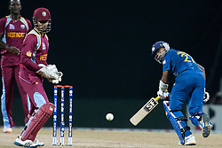 © Licensed to London News Pictures. 29/09/2012. Sri Lankan Mahela Jayawardene sets off for a run as the ball goes past the wicketkeeper during the T20 Cricket World super 8's match between Sri Lanka Vs West Indies at the Pallekele International Stadium Cricket Stadium, Pallekele. Photo credit : Asanka Brendon Ratnayake/LNP