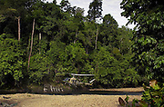 Military helicopter hovers in clearing in Ulu Temburong National Park, Brunei