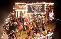 © Licensed to London News Pictures. 14/11/2014. Somerset, UK Participants take part in what widely regarded as one of the largest illuminated processions in the world on 15th November 2014. Dedicated members of the numerous carnival clubs who take part design and build carts in secrecy, using thousands of pounds of their own money in a bid to win awards for the best carts. The 3 week-long spectacle can draw crowds of up to 150,000 and sees hundreds of entries from across the county. The specially-designed carts can measure up to 100ft long, feature state-of-the-art electronics and hydraulics, and are decorated with tens of thousands of light bulbs. The spectacle concludes at Glastonbury tonight . Photo credit : Jason Bryant/LNP