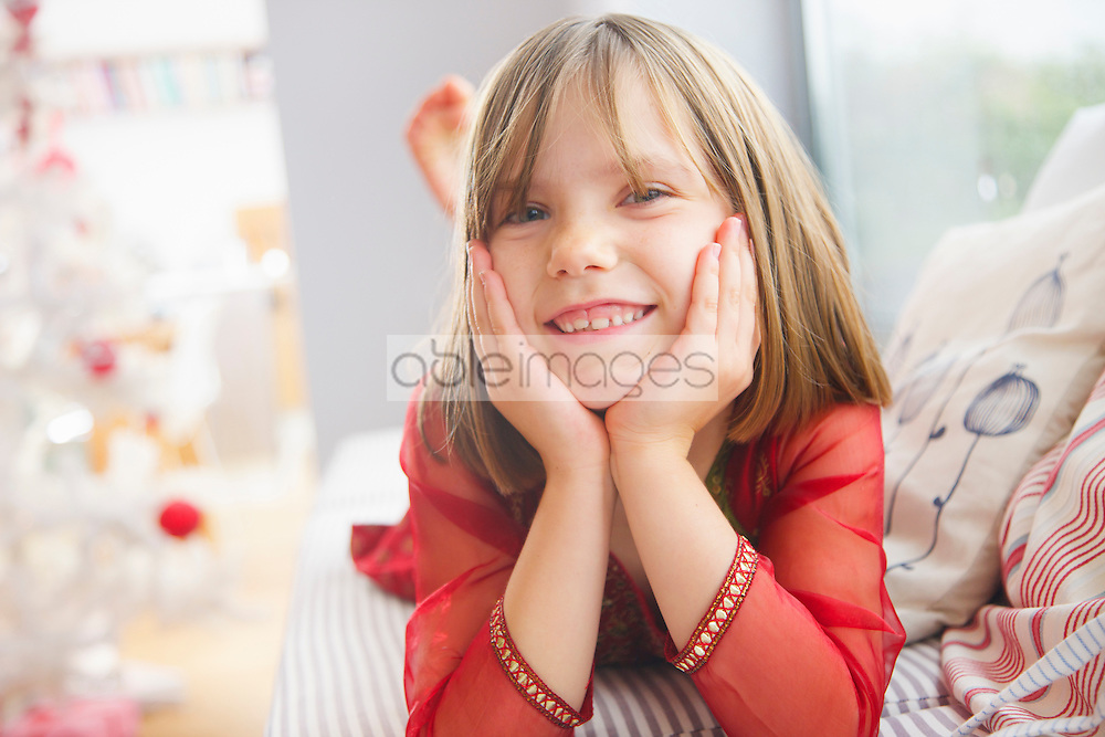 Smiling Young Girl with Hands on Face