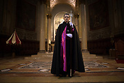 A priest inside the Basilica of St. Mary. Silence night procession in Maundy Thursday at the city center of Mataró city (Barcelona), during Easter 2015. Eva Parey/4SEE.