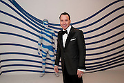 DAVID FURNISH, Grey Goose character and cocktails. The Elton John Aids Foundation Winter Ball. off Nine Elms Lane. London SW8. 30 October 2010. -DO NOT ARCHIVE-© Copyright Photograph by Dafydd Jones. 248 Clapham Rd. London SW9 0PZ. Tel 0207 820 0771. www.dafjones.com.