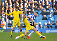 Leeds United Defender Liam Cooper beats Sheffield Wednesday Forward Gary Hooper to the ball during the Sky Bet Championship match between Sheffield Wednesday and Leeds United at Hillsborough, Sheffield, England on 16 January 2016. Photo by Adam Rivers.