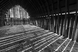 Light through slats of weathered barn, Muleshoe Historic Farm, Hill Country, Comfort, Texas, USA.