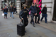 A man dressed in the armour of a medieval Japanese Samurai warrior walks along Regent Street, to the curiosity of other pedestrians, on 4th May 2017, in London, England.