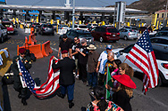 Deported U.S. military veterans gather during a Veteran's Day ceremony at the San Ysidro Port of Entry to the United States in Tijuana, Baja California, México, Sunday, November 11, 2018.