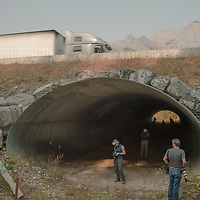 A photography group examines extensive fencing and wildlife tunnels that enable animals to safely cross the Trans-Canada Highway in Banff National Park, Alberta, Canada.