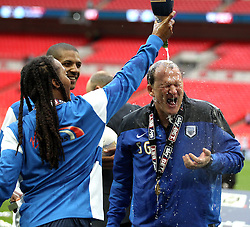 Preston North End's Daniel Johnson pours champagne on Preston North End Manager Simon Grayson - Photo mandatory by-line: Robbie Stephenson/JMP - Mobile: 07966 386802 - 24/05/2015 - SPORT - Football - London - Wembley Stadium - Preston North End v Swindon Town - League One Playoff Final