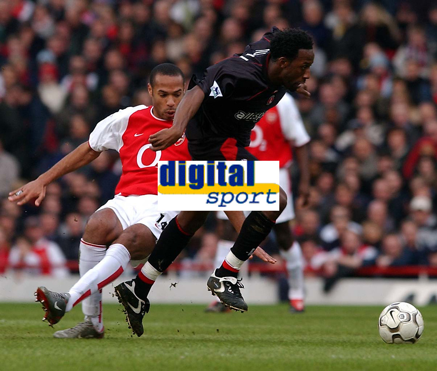 Photo. Javier Garcia<br />02/03/2003 Arsenal v Charlton, FA Barclaycard Premiership, Highbury<br />Thierry Henry swings and misses both the ball and Chalrton's Jason Euell