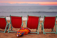 Abandoned beach chairs and setting sun signal the end of the day, Sayulita Mexico