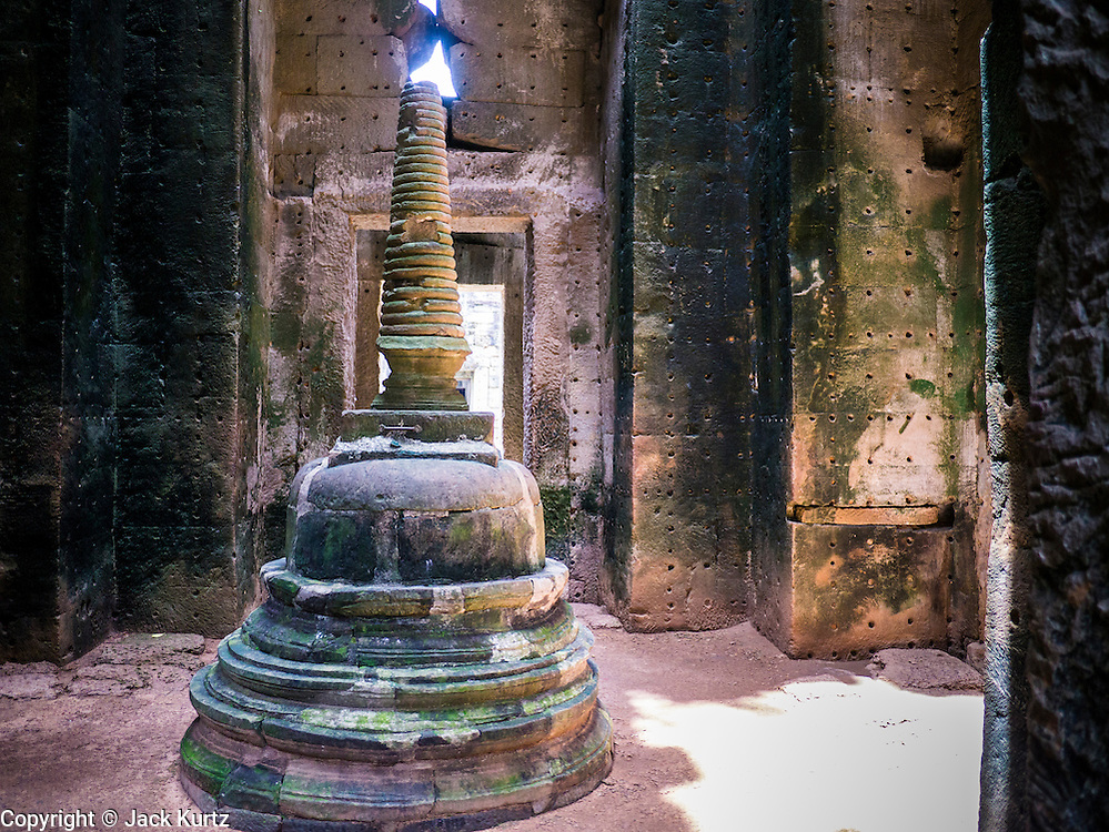 "02 JULY 2013 - ANGKOR WAT, SIEM REAP, SIEM REAP, CAMBODIA:  Interior of Preah Khan in the Angkor Wat complex. Angkor Wat is the largest temple complex in the world. The temple was built by the Khmer King Suryavarman II in the early 12th century in Yasodharapura (present-day Angkor), the capital of the Khmer Empire, as his state temple and eventual mausoleum. Angkor Wat was dedicated to Vishnu. It is the best-preserved temple at the site, and has remained a religious centre since its foundation – first Hindu, then Buddhist. The temple is at the top of the high classical style of Khmer architecture. It is a symbol of Cambodia, appearing on the national flag, and it is the country's prime attraction for visitors. The temple is admired for the architecture, the extensive bas-reliefs, and for the numerous devatas adorning its walls. The modern name, Angkor Wat, means ""Temple City"" or ""City of Temples"" in Khmer; Angkor, meaning ""city"" or ""capital city"", is a vernacular form of the word nokor, which comes from the Sanskrit word nagara. Wat is the Khmer word for ""temple grounds"", derived from the Pali word ""vatta."" Prior to this time the temple was known as Preah Pisnulok, after the posthumous title of its founder. It is also the name of complex of temples, which includes Bayon and Preah Khan, in the vicinity. It is by far the most visited tourist attraction in Cambodia. More than half of all tourists to Cambodia visit Angkor.         PHOTO BY JACK KURTZ"
