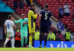 Scotland goalkeeper David Marshall with Grant Hanley at the final whistle following the UEFA Euro 2020 Group D match at Hampden Park, Glasgow. Picture date: Monday June 14, 2021.