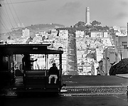 San Francisco cable car with Coit Tower and Telegraph Hill in the distance