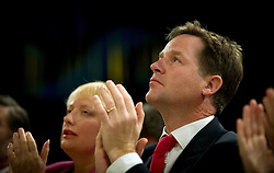 © London News Pictures. 25/09/2012. Brighton, UK.  Leader of the Liberal Democrats, Nick Clegg listening to Chief Secretary to the Treasury, Danny Alexander deliver his speech on day 4 of the Liberal Democrat Conference in Brighton on September 25, 2012. Photo credit : Ben Cawthra/LNP.