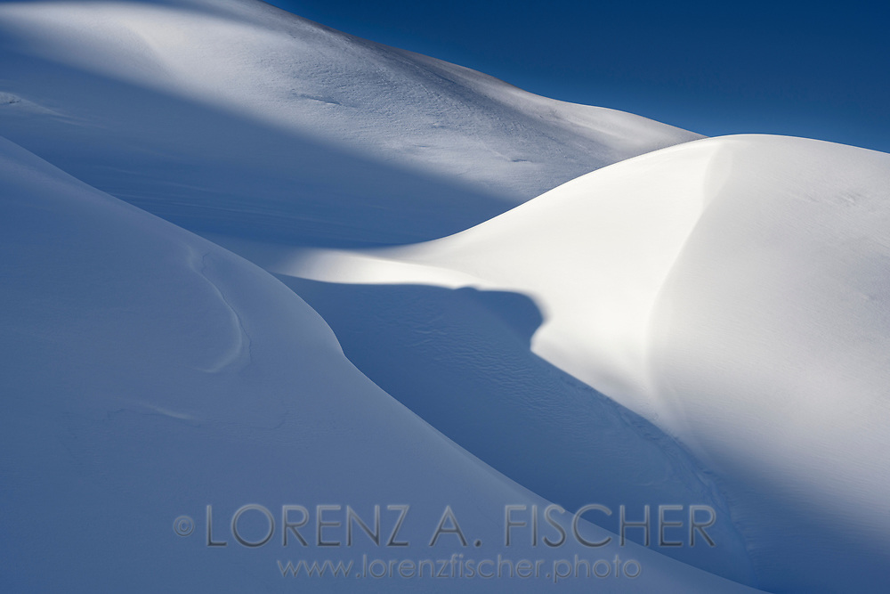 Light and shadow on the slopes on the way up to Piz d'Emmat Dadaint, Julier Pass, Grisons, Switzerland