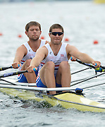 Trackai. LITHUANIA. GBRM2X, Bow Jack BEAUMONT and Jonathan WALTON move away from the start in their morning heat in the men's double sculls on Lake Galve. 2012 FISA U23 Rowing Championships,  11:08:04 Thursday 12/07/2012 [Mandatory credit: Peter Spurrier/Intersport Images]..Rowing, U23, 2012.