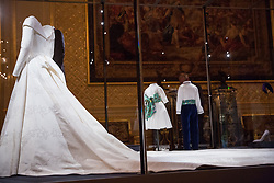 Windsor, UK. 28th February, 2019. HRH Princess Eugenie's wedding dress, created by Peter Pilotto and Christopher De Vos of the British-based label Peter Pilotto, and Mr Jack Brooksbank's morning suit made by tailors at Huntsman on Savile Row, which go on display with other items from their wedding outfits at Windsor Castle in a special exhibition named 'A Royal Wedding: HRH Princess Eugenie and Mr Jack Brooksbank' from 1st March to 22nd April. Other items included in the exhibition include the Greville Emerald Kokoshnik Tiara, on public display for the first time, two diamond wheat-ear brooches, diamond and emerald drop earrings, Princess Eugenie's evening gown, HRH Princess Beatrice's blue dress by the London-based couture house Ralph & Russo and headpiece by British milliner Sarah Cant and a bridesmaid and pageboy outfit by London-based children's designer Amaia Kids.