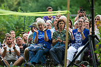 The crowd reacts as Senator Elizabeth Warren speaks during a House Party held in Wolfeboro on Wednesday evening. (Karen Bobotas/for the Laconia Daily Sun)