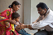 A sick child has his chest examined by the doctor in the CINI health clinic. Child In Need Institute (CINI) is based in Kolkata, India. It is a non-governmental organisation (NGO), which provides sustainable development in health, nutrition, education and security for the poorest communities in West Bengal, Jharkhand, Chattisgarh and Madhya Pradesh states.