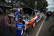 June 26-30 - Pikes Peak, Colorado. Paul Dallenbach's team works on his Hyundai prior to the 91st running of the Pikes Peak Hill Climb.