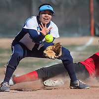 032515       Cable Hoover<br /> <br /> Window Rock Scout Brittney Shirley (4) makes the catch as St. Michael Cardinal Delila Nakaidinae (27) slides into third Wednesday at Window Rock High School.