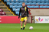 Burton Albion midfielder Jamie Allen as he warms up for the The FA Cup 1st round match between Scunthorpe United and Burton Albion at Glanford Park, Scunthorpe, England on 10 November 2018.