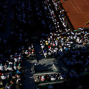 'Slam the Light'<br /> <br /> The summer light of the four tennis grand slams in Australia, France, England and USA provide an amazing contrast of light and condition, each tournament providing a uniqueness and beauty.<br />  From the harsh Australian summer light of Melbourne, to the spring light reflecting off the clay courts of Roland Garros in Paris, the low and late setting northern summer light casting beautiful long shadows on the lush Wimbledon grass in London and the early autumn soft subtle light of Flushing Meadows in New York.<br /> <br /> <br /> Fernando Gonzalez, Chile on his way to victory over Andy Murray, Great Britain in the Men's Quarter Final match at the French Open Tennis Tournament at Roland Garros, Paris, France on Tuesday, June 2, 2009.