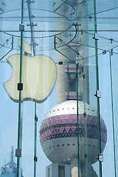 Detail of Apple logo in store with Pearl Oriental Tower to rear in Shanghai China