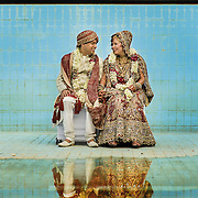 A newlywed couple sit for a couple shoot in the empty pool of a farmhouse, on the outskirts of Delhi, where their Hindu wedding took place (2010)