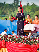 01 NOVEMBER 2015 - YANGON, MYANMAR:  AUNG SAN SUU KYI, the head of the NLD, speaks to the crowd at the NLD's last election rally of the 2015 election in the Yangon suburbs Sunday. Political parties are wrapping up their campaigns in Myanmar (Burma). National elections are scheduled for Sunday Nov. 8. The two principal parties are the National League for Democracy (NLD), the party of democracy icon and Nobel Peace Prize winner Aung San Suu Kyi, and the ruling Union Solidarity and Development Party (USDP), led by incumbent President Thein Sein. There are more than 30 parties campaigning for national and local offices.     PHOTO BY JACK KURTZ