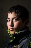 Ghaidaa, age 16, from Idlib, a Syrian refugee boy at a the Free Syria school.